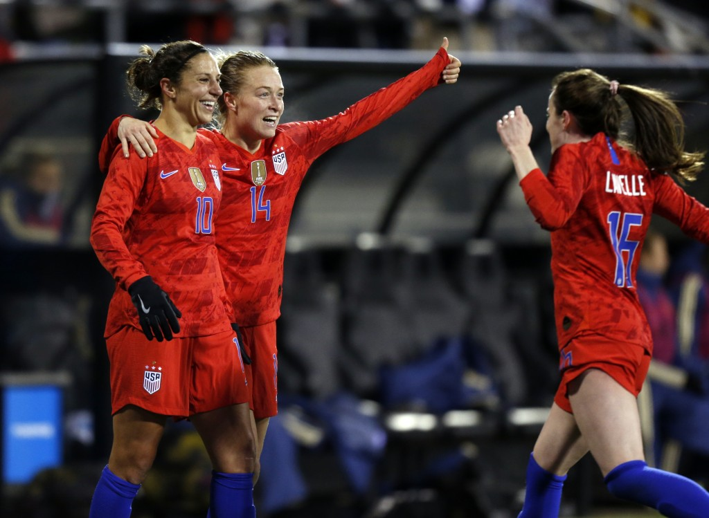 United States forward Carli Lloyd, left, defender Emily Sonnett, center, and midfielder Rose Lavelle celebrate Lloyd's second goal against Sweden duri...