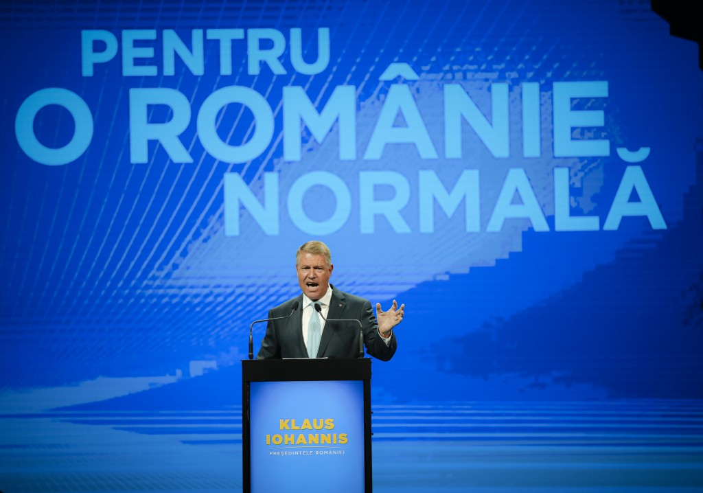 FILE- In this Thursday, Aug. 8, 2019, file picture, Romanian President Klaus Iohannis waves to supporters during the National Council of the Liberal P...
