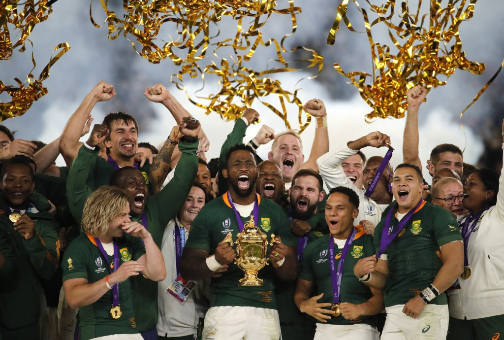 In this Saturday, Nov. 2, 2019, file photo, South African captain Siya Kolisi holds the Webb Ellis Cup aloft after South Africa defeated England to wi...
