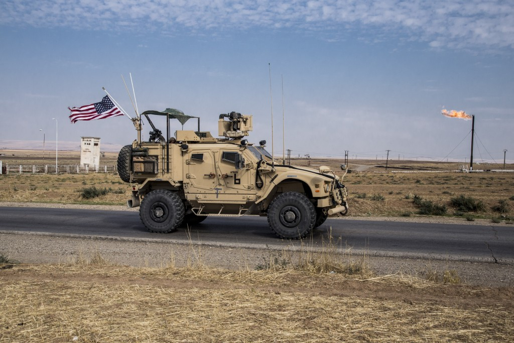 FILE - In this Monday, Oct. 28, 2019 file photo, U.S. forces patrol Syrian oil fields, in eastern Syria.President Donald Trump's decision to dispatch ...