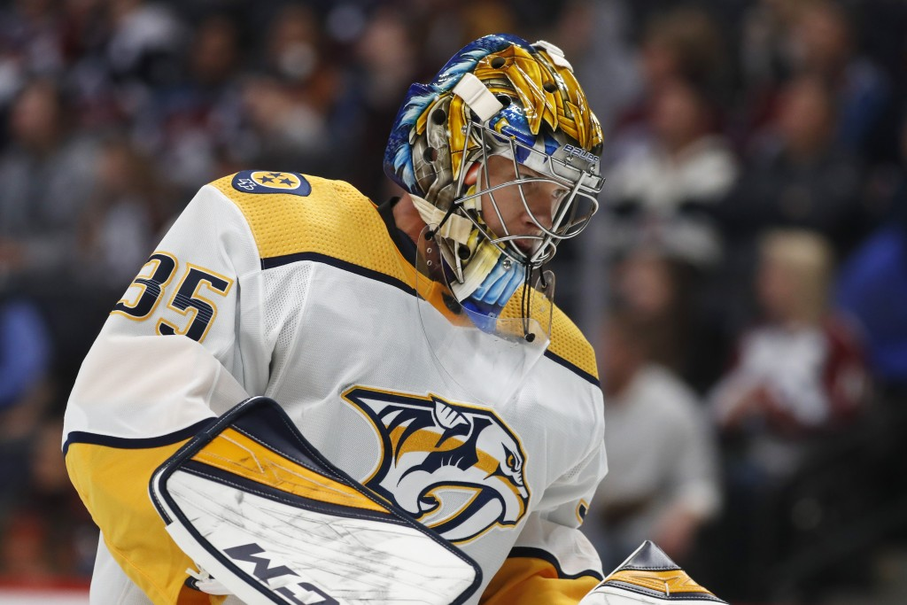 Nashville Predators goaltender Pekka Rinne pauses after giving up a goal to Colorado Avalanche defenseman Cale Makar during the first period of an NHL...
