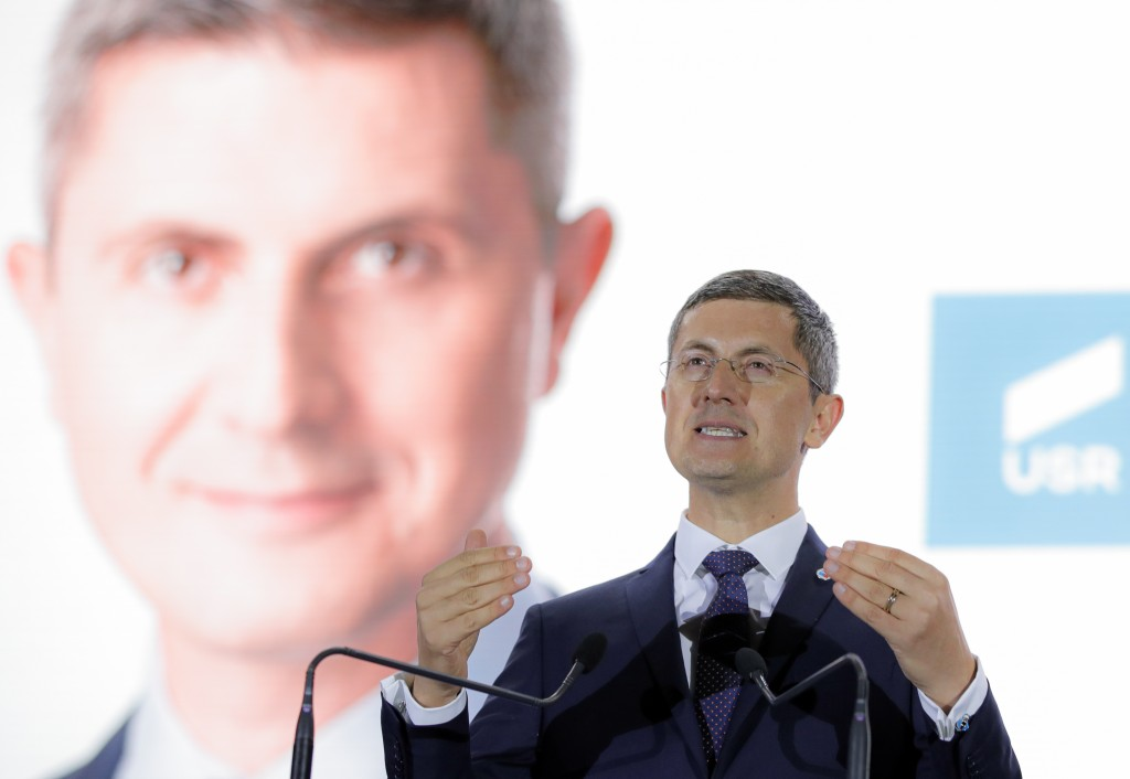 In this photo dated Thursday, Nov. 7, 2019, Dan Barna, the presidential candidate of the USR-Plus Alliance, speaks at a rally in Bucharest, Romania. R...