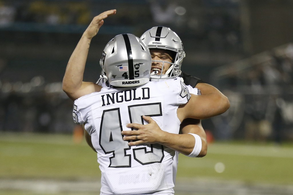 Oakland Raiders running back Alec Ingold (45) celebrates with quarterback Derek Carr after they connected on a touchdown pass against the Los Angeles ...