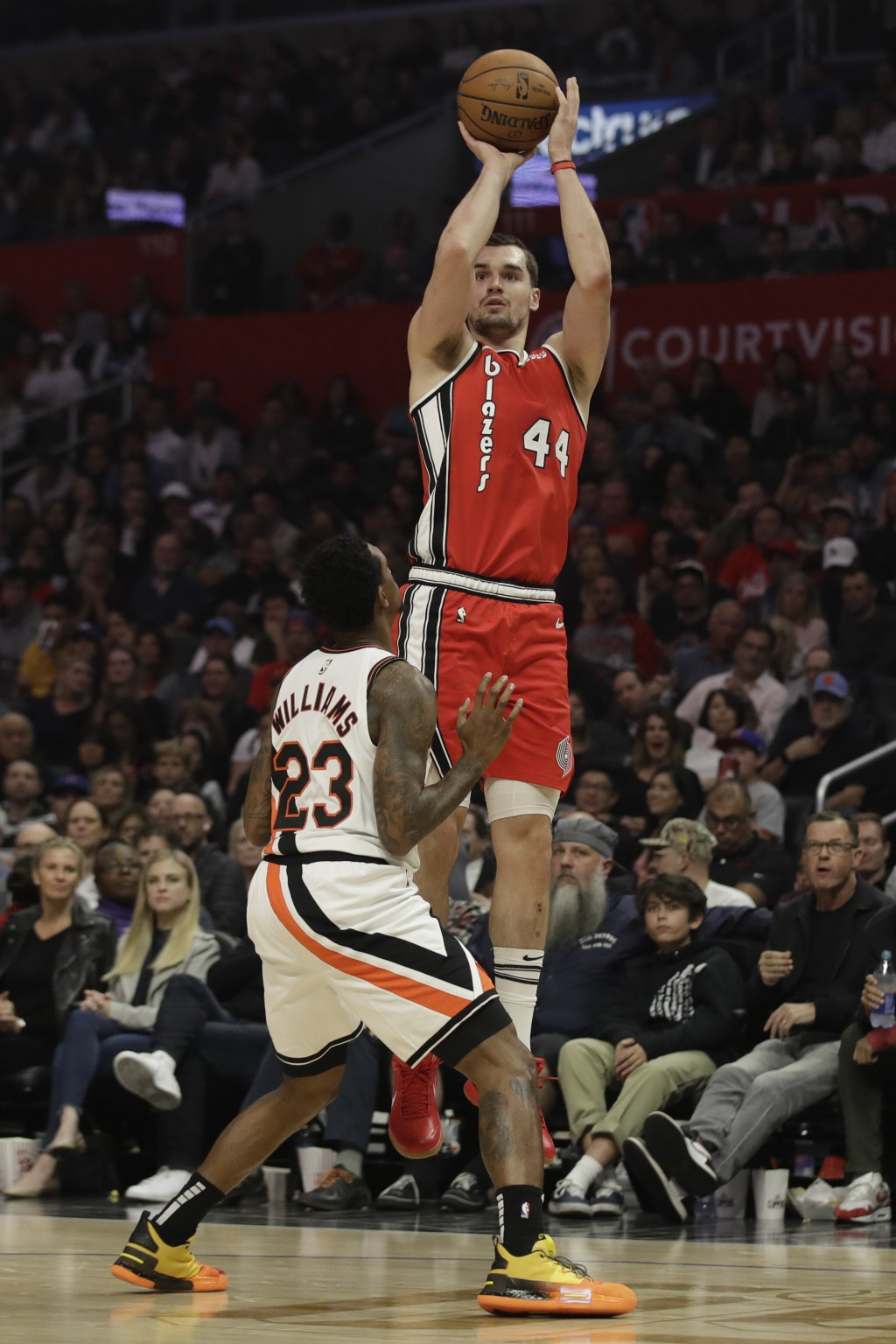 Portland Trail Blazers' Mario Hezonja (44) shoots over Los Angeles Clippers' Lou Williams (23) during the first half of an NBA basketball game Thursda...