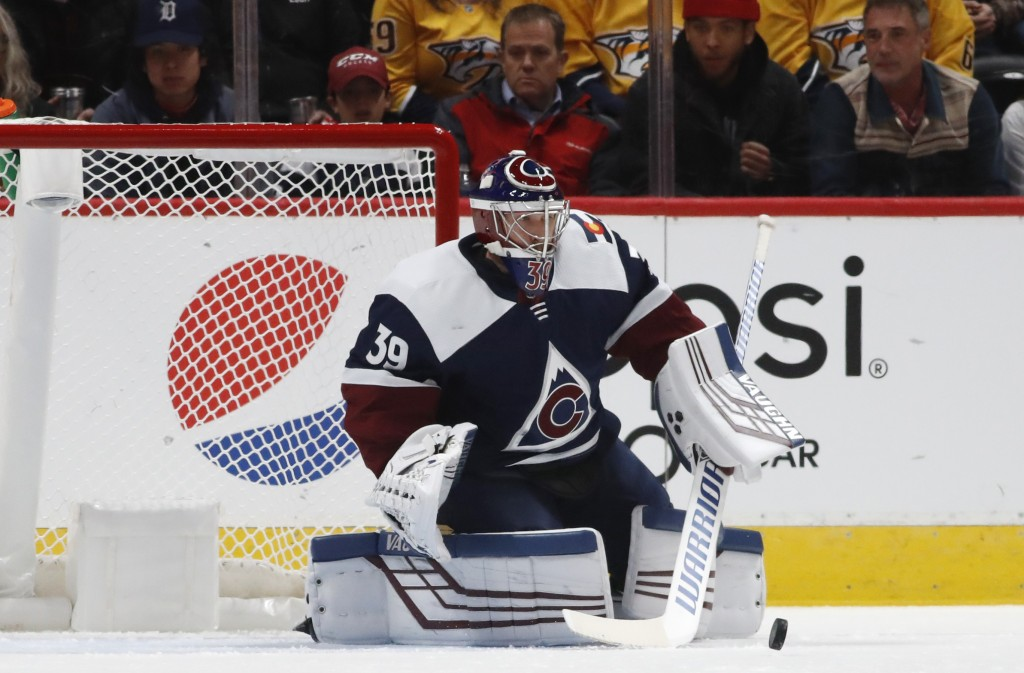 Colorado Avalanche goaltender Pavel Francouz makes a stick save against the Nashville Predators during the first period of an NHL hockey game Thursday...