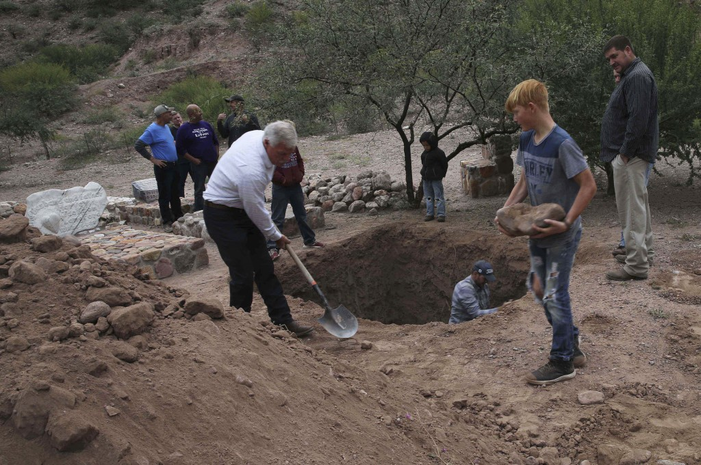 Men dig a mass grave for some of the women and children related to the extended LeBaron family who were killed by drug cartel gunmen, before their bur...