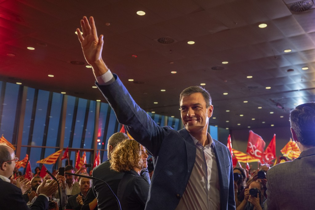 In this photo taken on Wednesday, Oct. 9, 2019 photo, Spanish socialist candidate Pedro Sanchez, waves to supporters during a campaign rally in Barcel...
