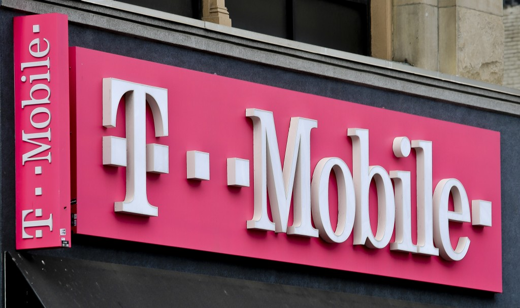FILE - This April 30, 2018, photo shows a T-Mobile store in Herald Square in New York. T-Mobile promises a new $15 wireless plan and other initiatives...