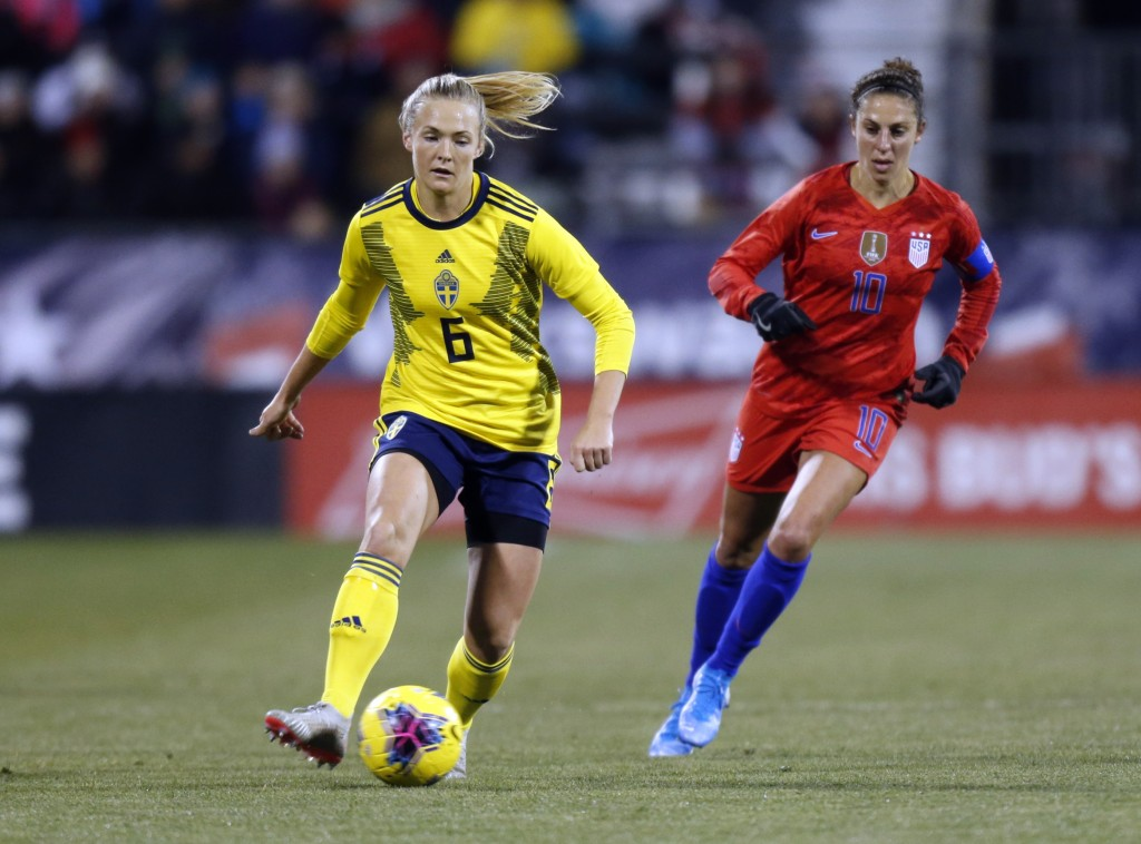 Sweden defender Magdalena Eriksson, left, controls the ball against United States forward Carli Lloyd during the first half of a women's international...