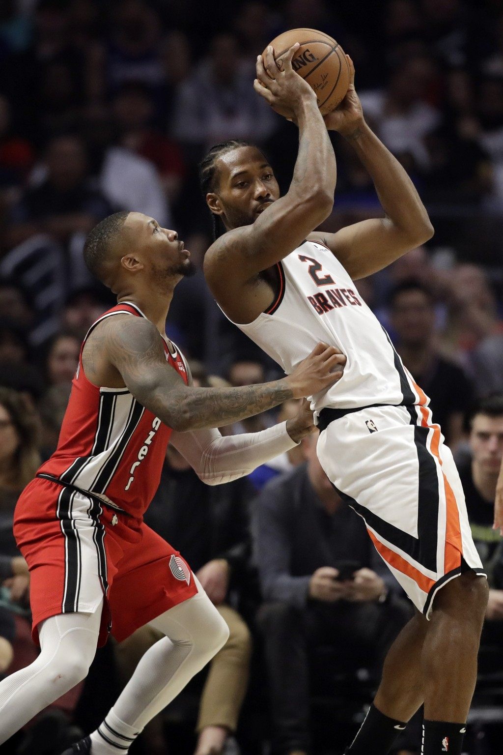 Los Angeles Clippers' Kawhi Leonard (2) is defended by Portland Trail Blazers' Damian Lillard during the first half of an NBA basketball game Thursday...
