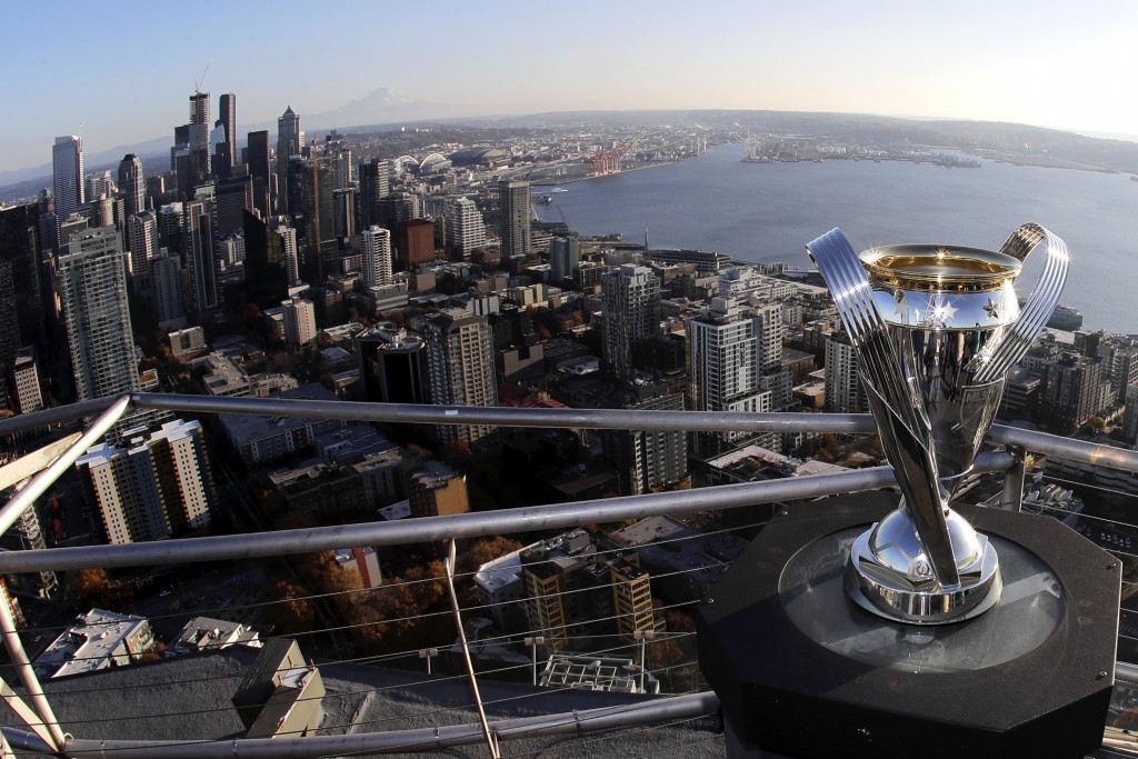 In this Nov. 5, 2019, photo, the MLS Cup trophy is displayed on the roof of the Space Needle with the downtown Seattle in the background. Seattle will...