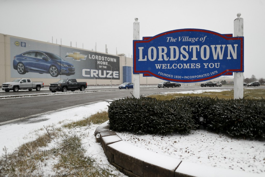 FILE- In this Nov. 27, 2018, file photo a banner depicting the Chevrolet Cruze model vehicle is displayed at the General Motors' Lordstown plant in Lo...
