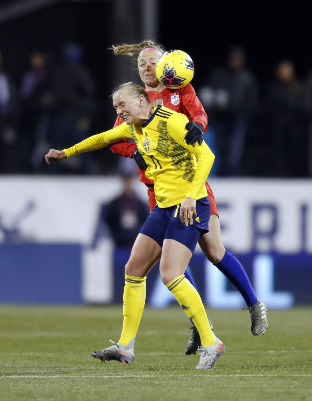 Sweden forward Stina Blackstenius, left, heads the ball in front of United States defender Becky Sauerbrunn during the first half of a women's interna...