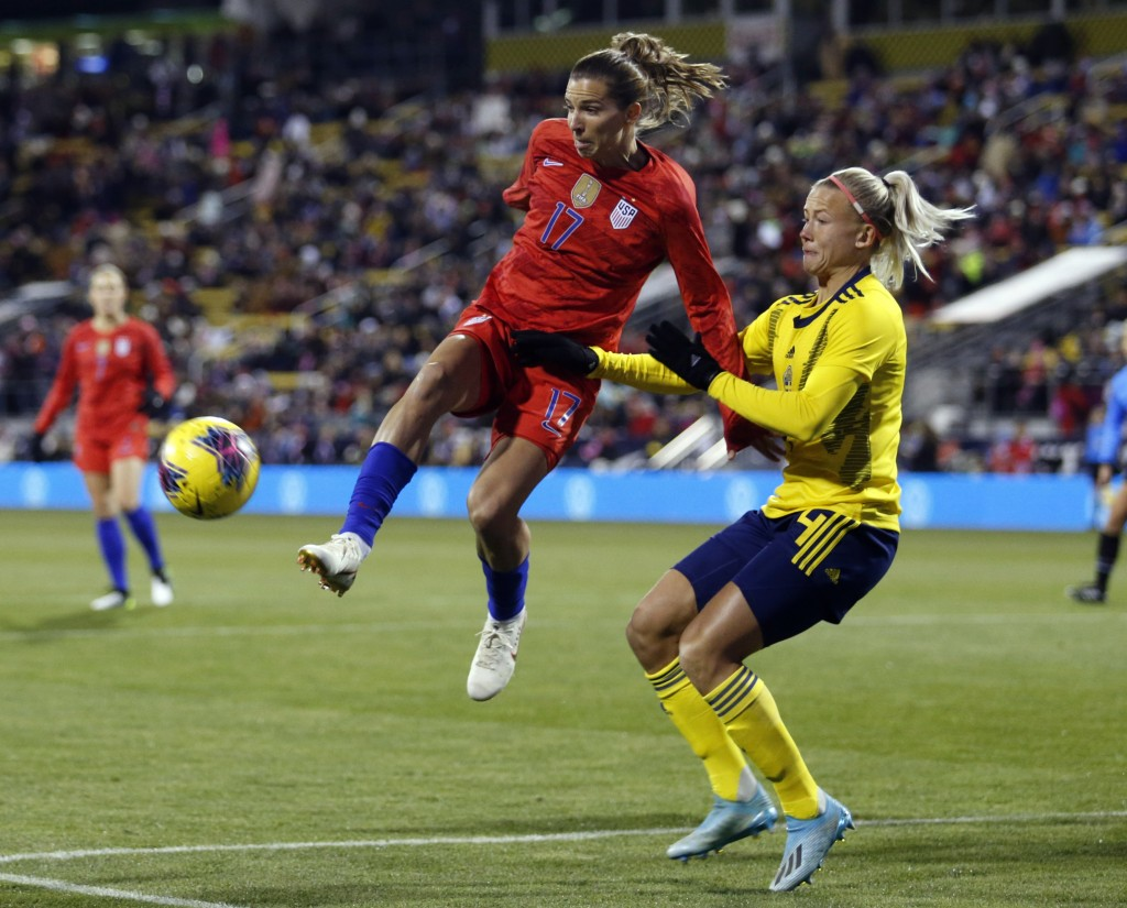 United States forward Tobin Heath, left, passes the ball in front of Sweden defender Hanna Glas during the first half of a women's international frien...