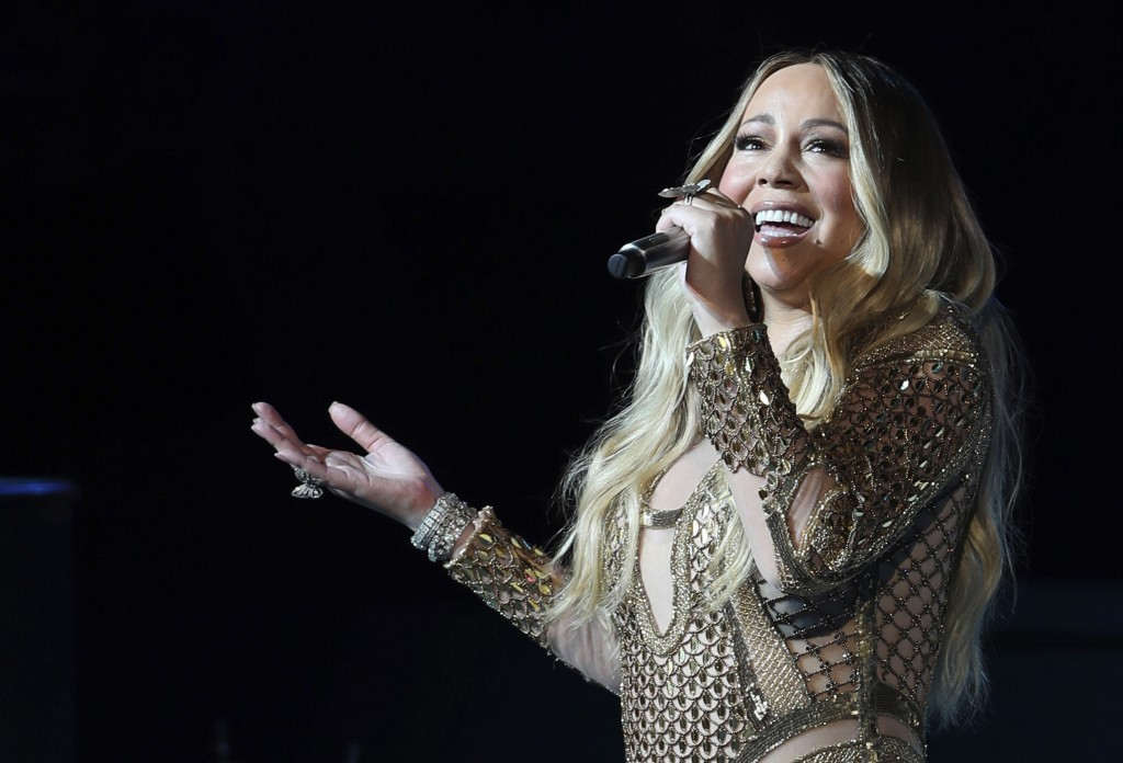 FILE - This Oct. 20, 2019 file photo shows Mariah Carey performing during a concert celebrating Dubai Expo 2020 One Year to Go in Dubai, United Arab E...