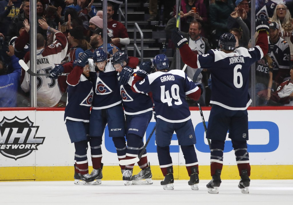 Colorado Avalanche left wing Andre Burakovsky, second from left, celebrates hia goal with, from left, centers T.J. Tynan and Vladislav Kamenev and def...