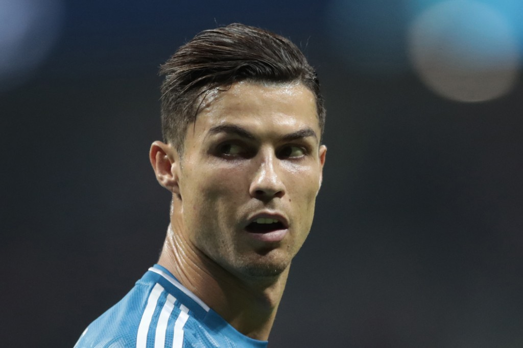 FILE - In this Sept. 18, 2019, file photo, Juventus' Cristiano Ronaldo looks back during the Champions League Group D soccer match between Atletico Ma...