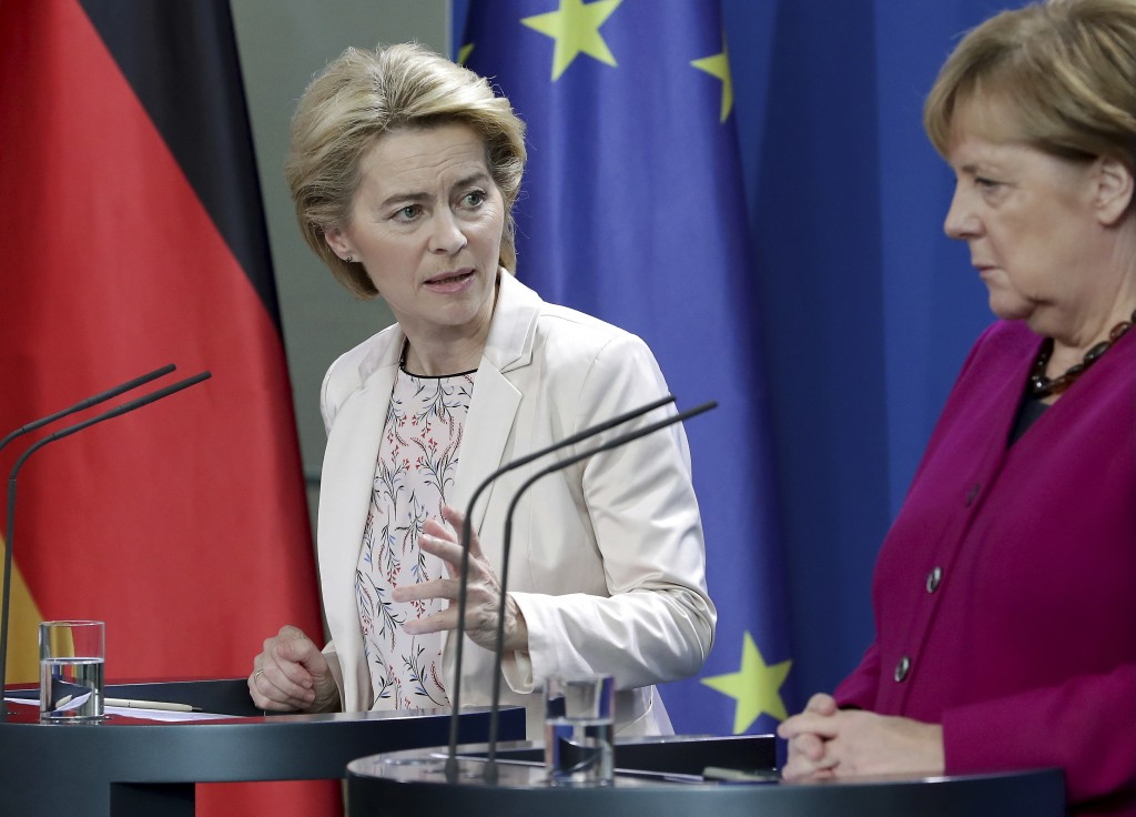 German Chancellor Angela Merkel, right, and the designated President of the European Commission, Ursula von der Leyen, left, address the media during ...