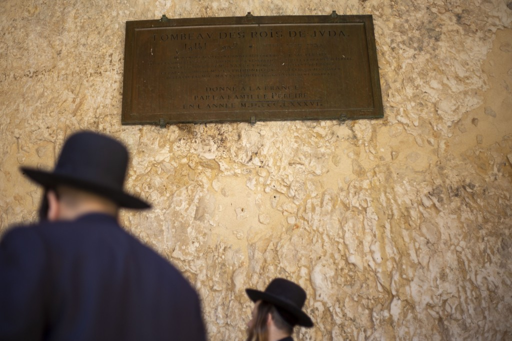 In this Thursday, Oct. 31, 2019 photo, An ultra-Orthodox Jew pray in the Tomb of the Kings, a large underground burial complex dating to the first cen...