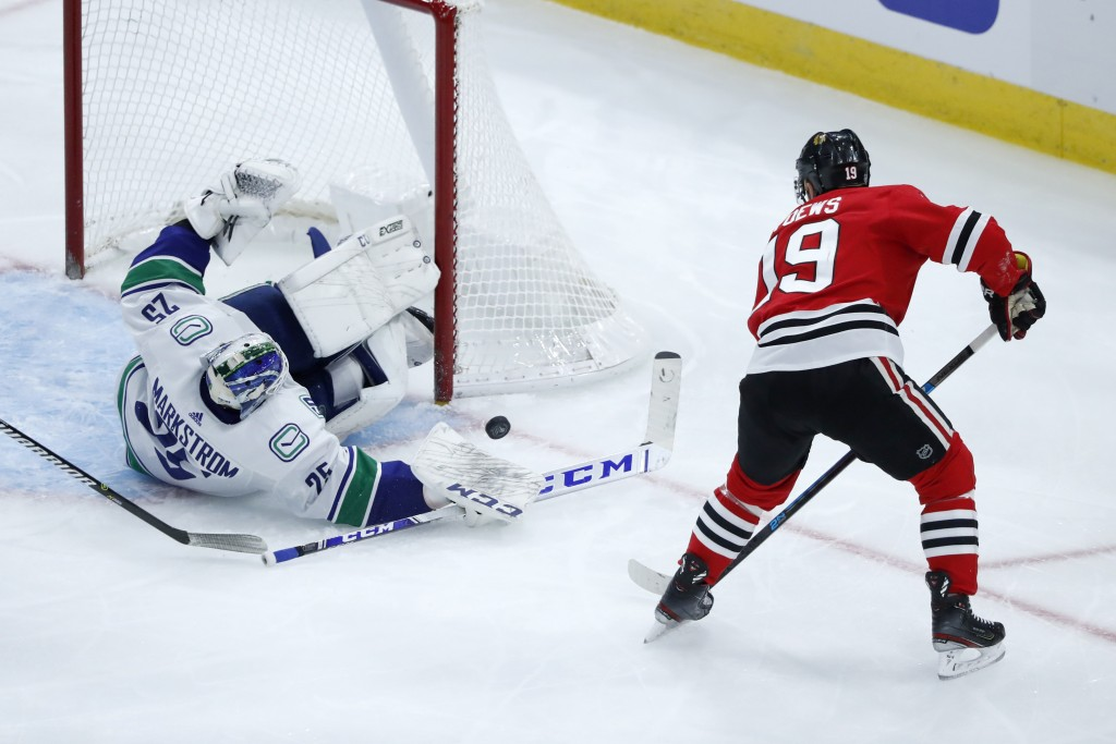 Vancouver Canucks goaltender Jacob Markstrom makes a save on a shot by Chicago Blackhawks' Jonathan Toews during the second period of an NHL hockey ga...