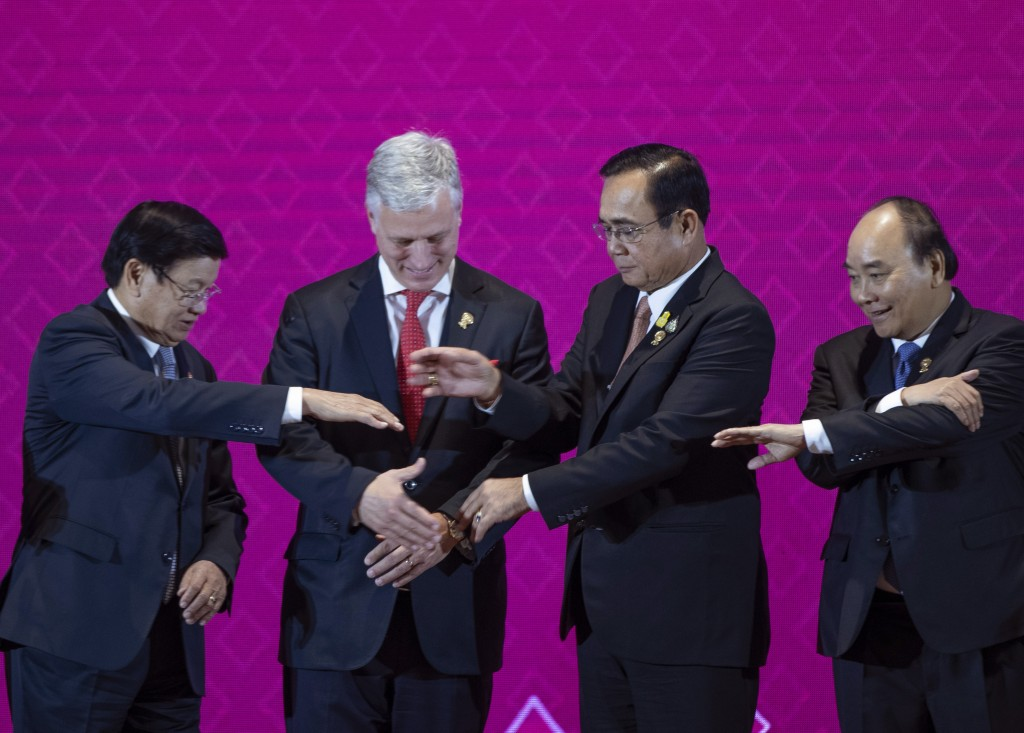 In this Monday, Nov. 4, 2019, file photo, U.S. National Security Adviser Robert O'Brien, second left, with ASEAN leaders, from left, Laos Prime Minist...