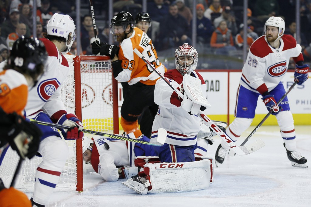 Montreal Canadiens' Carey Price (31) cannot block a goal by Philadelphia Flyers' James van Riemsdyk during the second period of an NHL hockey game, Th...