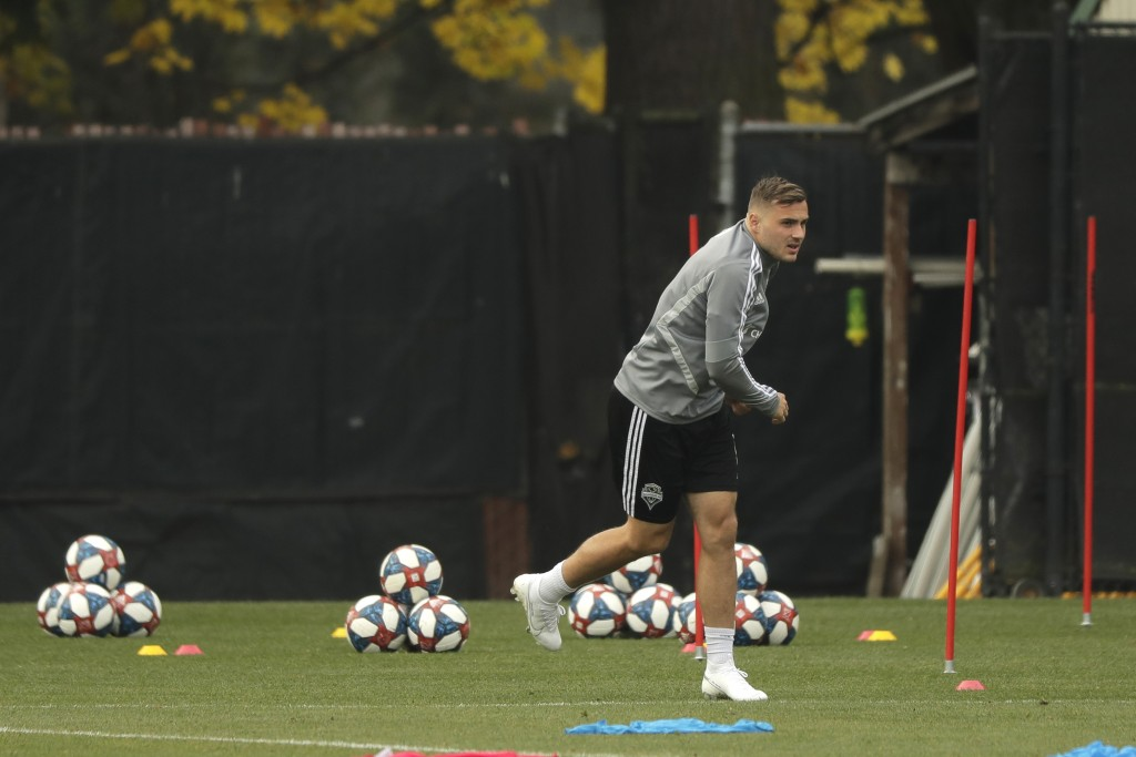 Seattle Sounders forward Jordan Morris warms up before a training session, Thursday, Nov. 7, 2019, in Tukwila, Wash. The Sounders will face Toronto FC...