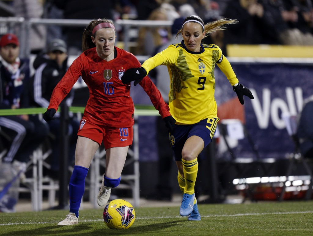 United States midfielder Rose Lavelle, left, chases the ball in front of Sweden midfielder Kosovare Asllani during the first half of a women's interna...