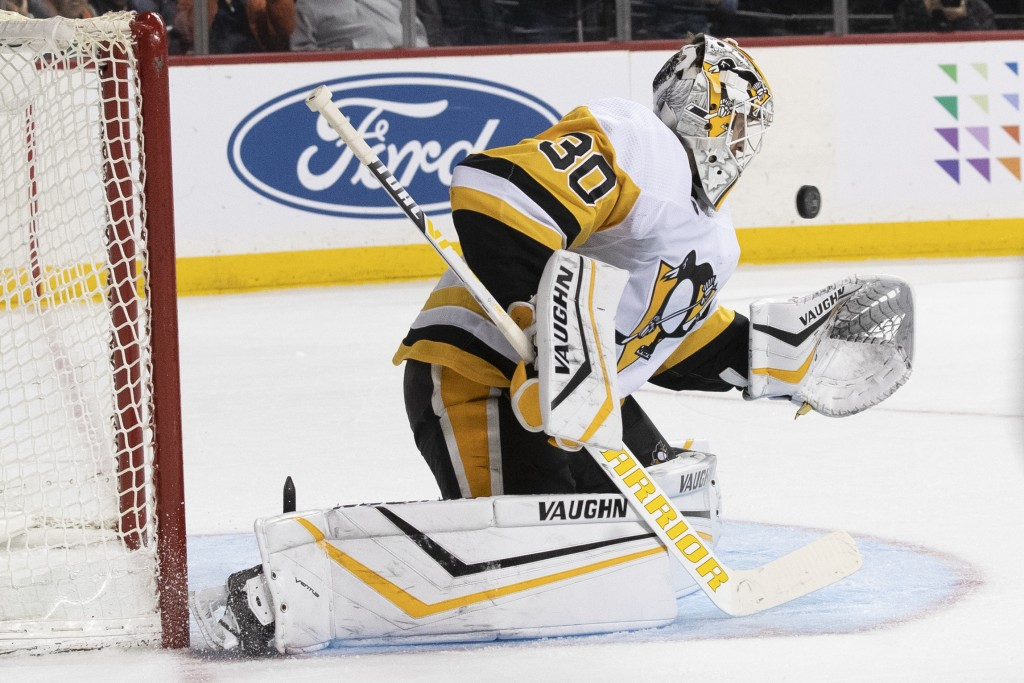 Pittsburgh Penguins goaltender Matt Murray makes a save against the New York Islanders during the second period of an NHL hockey game Thursday, Nov. 7...