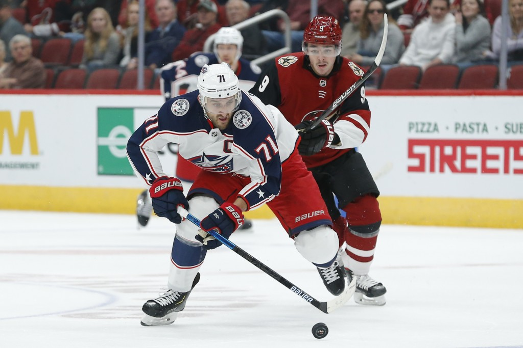 Columbus Blue Jackets left wing Nick Foligno (71) skates away from Arizona Coyotes center Clayton Keller in the first period during an NHL hockey game...