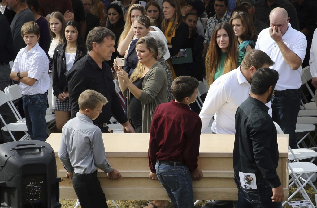 Youths and men carry a coffin during the funeral of Dawna Ray Langford, 43, and her sons Trevor, 11, and Rogan, 2, who were killed by drug cartel gunm...