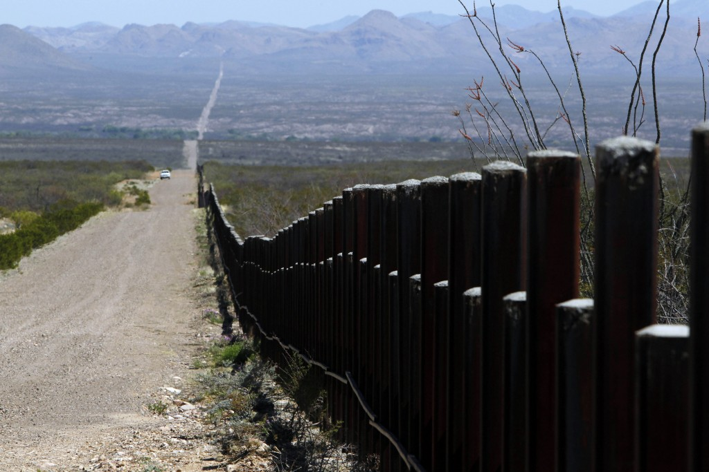 FILE - In this March 18, 2016, file photo, a U.S. Customs and Border Patrol truck patrols the U.S. border with Mexico in Douglas, Ariz. An unusual str...