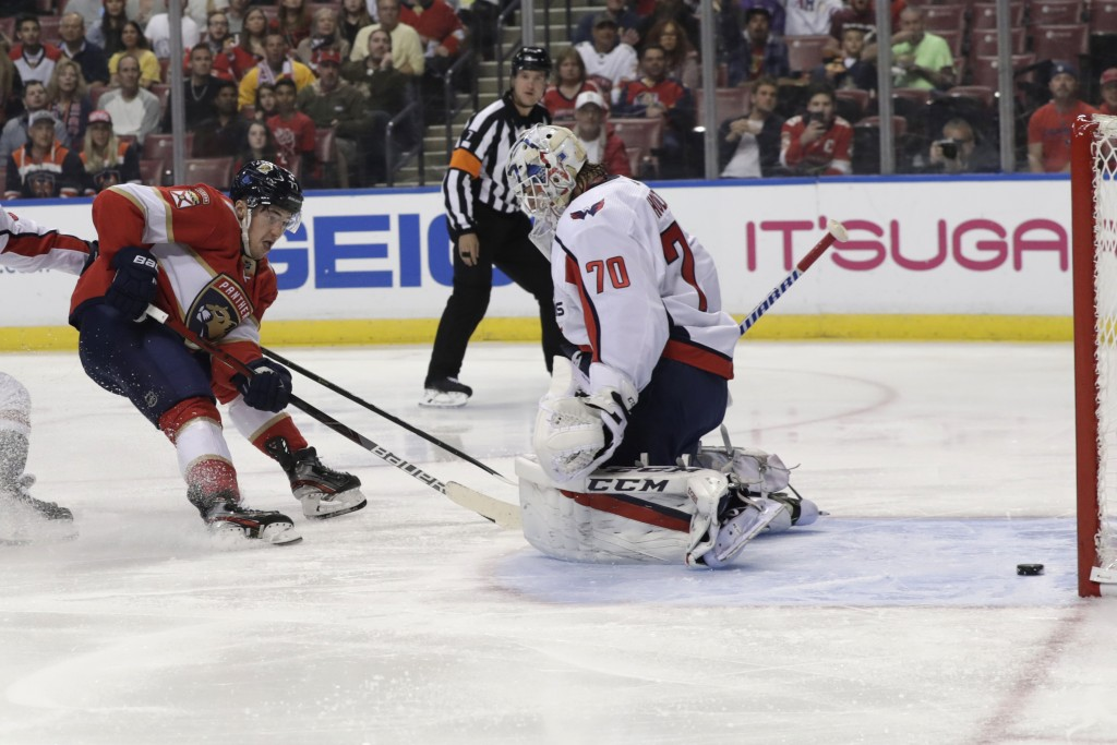 Florida Panthers center Frank Vatrano, left, scores a goal against Washington Capitals goaltender Braden Holtby (70) during the first period of an an ...