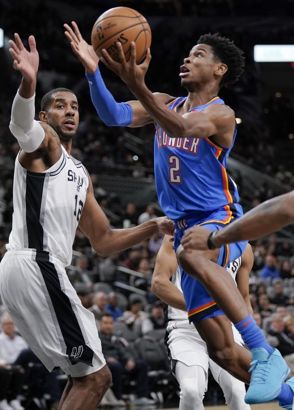 Oklahoma City Thunder's Shai Gilgeous-Alexander (2) shoots against San Antonio Spurs' LaMarcus Aldridge during the first half of an NBA basketball gam...