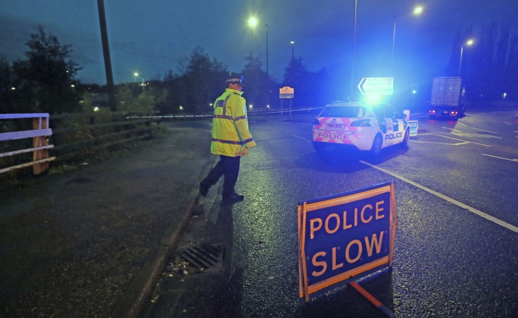 A police roadblock near Meadowhall shopping centre in Sheffield, England, where some people were forced to stay overnight after heavy rain and floodin...