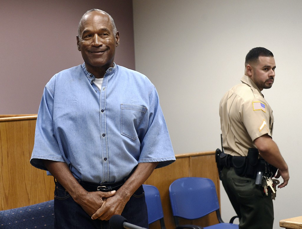 FILE - In this July 20, 2017, file photo, former NFL football star O.J. Simpson enters his parole hearing at the Lovelock Correctional Center in Lovel...
