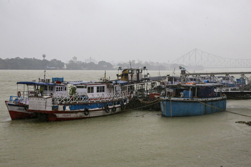 Mechanized boats and ferries stand moored at an empty jetty as ferry services were suspended due to cyclonic storm, on the Hooghly River in Kolkata, I...