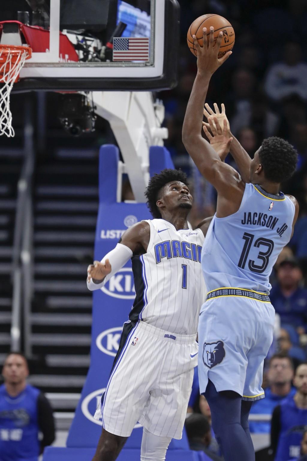 Memphis Grizzlies' Jaren Jackson Jr. (13) shoots over Orlando Magic's Jonathan Isaac (1) during the first half of an NBA basketball game, Friday, Nov....
