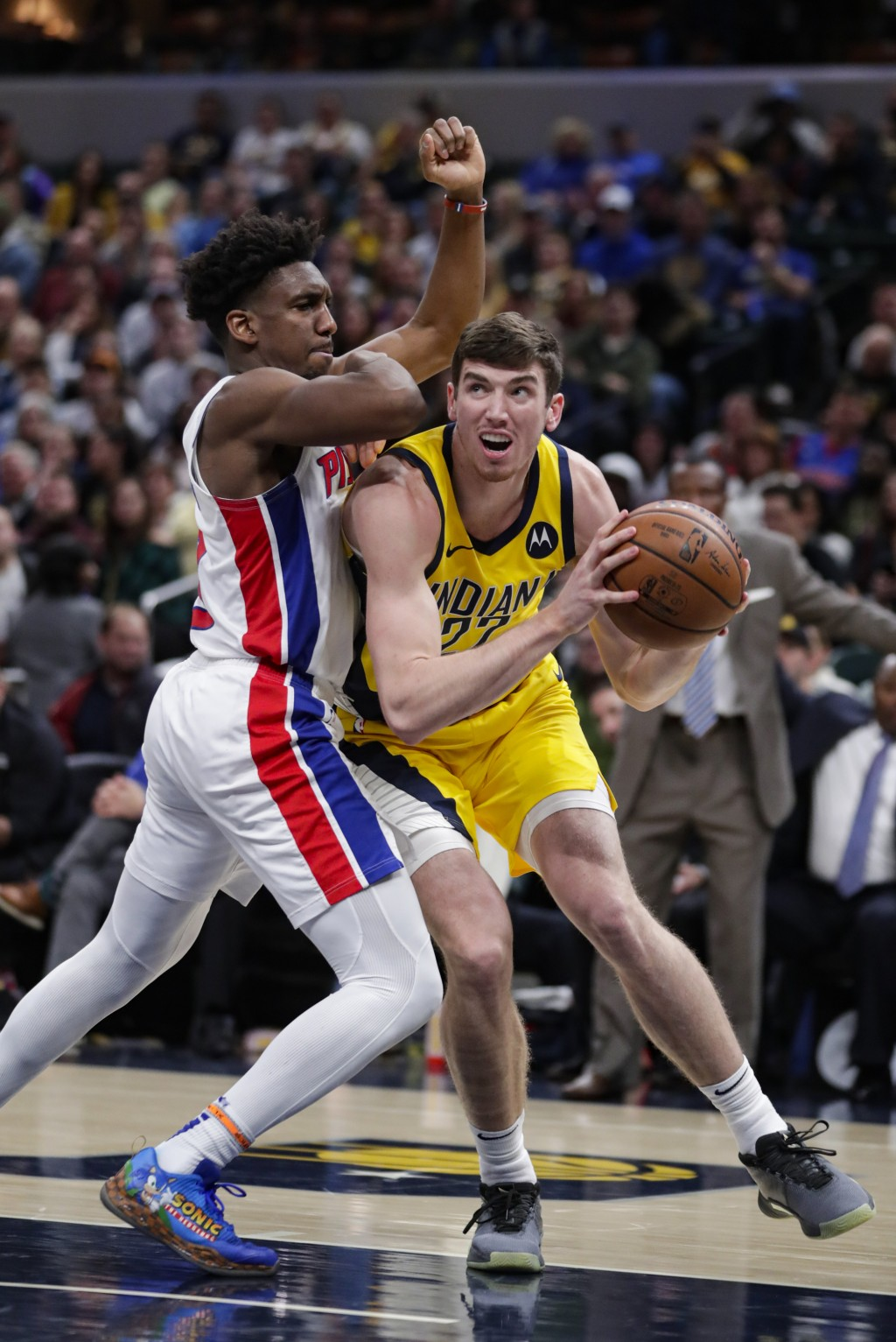 Indiana Pacers forward T.J. Leaf (22) looks to shoot over Detroit Pistons guard Langston Galloway (9) during the second half of an NBA basketball game...