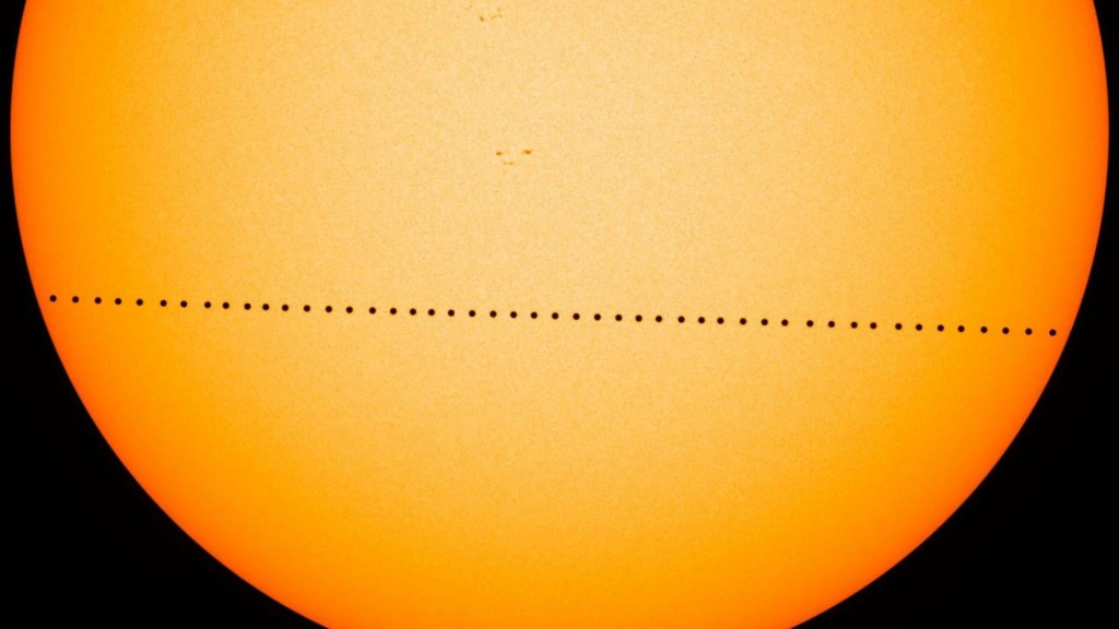 In this composite image provided by NASA, the planet Mercury passes directly between the sun and Earth on May 9, 2016 in a transit which lasted seven-...