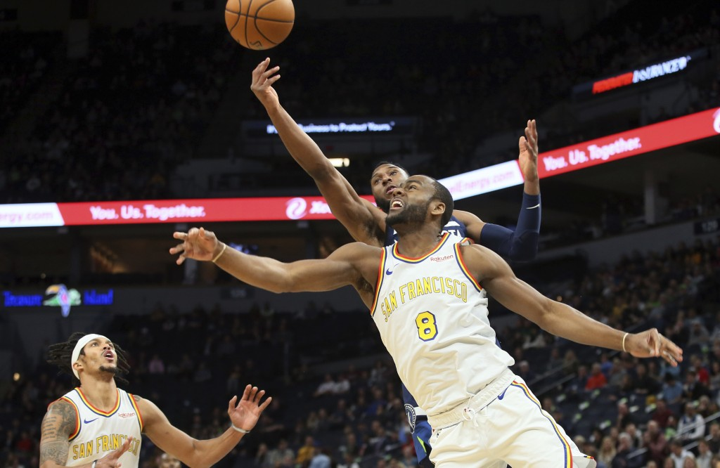 Minnesota Timberwolves' Josh Okogie, top right, of Nigeria, knocks the ball away from Golden State Warriors' Alec Burks (8) in the first half of an NB...