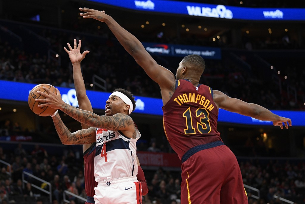 Washington Wizards guard Isaiah Thomas (4) goes to the basket past Cleveland Cavaliers center Tristan Thompson (13) during the first half of an NBA ba...