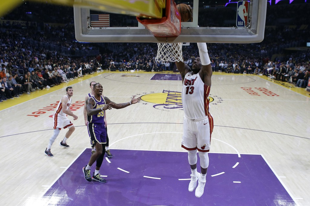 Miami Heat's Bam Adebayo (13) dunks past Los Angeles Lakers' Dwight Howard (39) during the first half of an NBA basketball game Friday, Nov. 8, 2019, ...