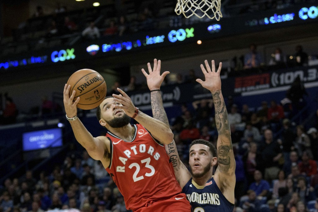 Toronto Raptors guard Fred VanVleet (23) shoots next to New Orleans Pelicans guard Lonzo Ball (2) during the first half of an NBA basketball game in N...