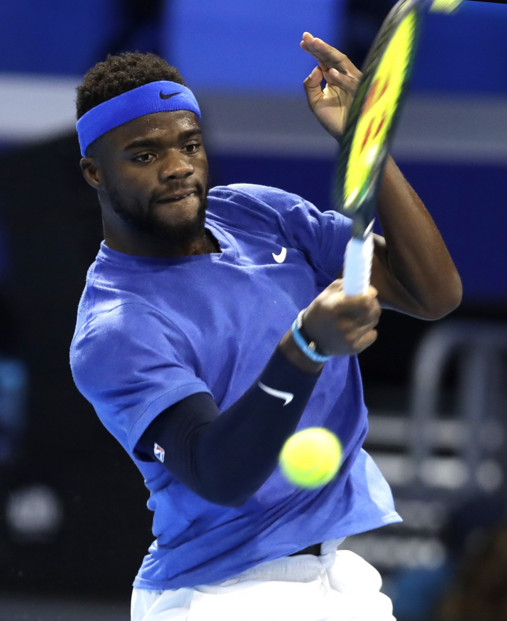 Frances Tiafoe, of the United States, returns the ball to Alex De Minaur, of Australia, during the ATP Next Gen tennis tournament semifinal match, in ...