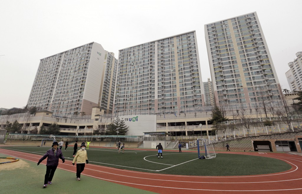 FILE - In this Jan. 28, 2016, file photo, residents exercise at a school near an apartment complex, the former location of the Brothers Home, in Busan...