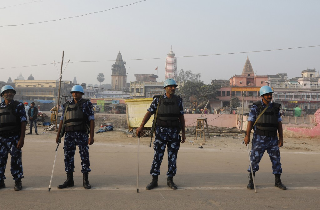 Security officers stand guard in Ayodhya, India , Saturday, Nov. 9, 2019. India's security forces were on high alert ahead of the Supreme Court's verd...