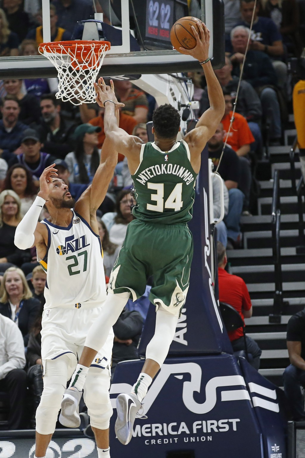 Utah Jazz center Rudy Gobert (27) defends against Milwaukee Bucks forward Giannis Antetokounmpo (34) during the first half of an NBA basketball game F...