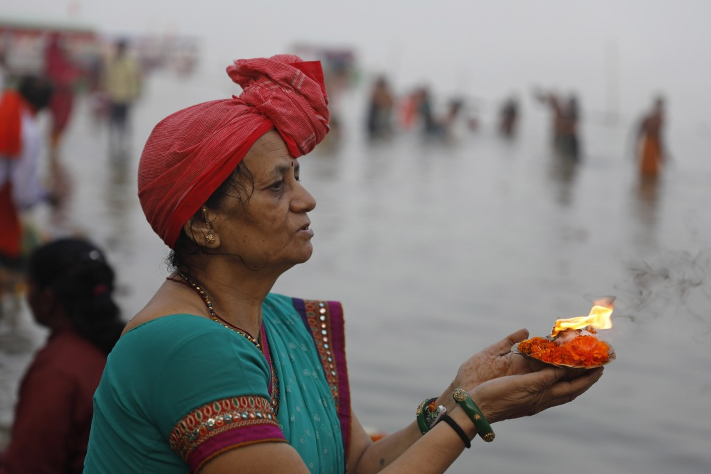 A Hindu pilgrim offers prayers by the River Sarayu in Ayodhya, India , Saturday, Nov. 9, 2019. India's security forces were on high alert ahead of the...
