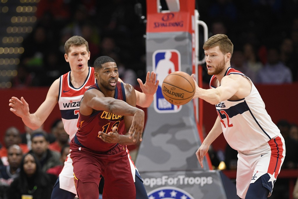 Cleveland Cavaliers center Tristan Thompson (13) passes the ball as Washington Wizards forward Moritz Wagner, back left, and forward Davis Bertans (42...